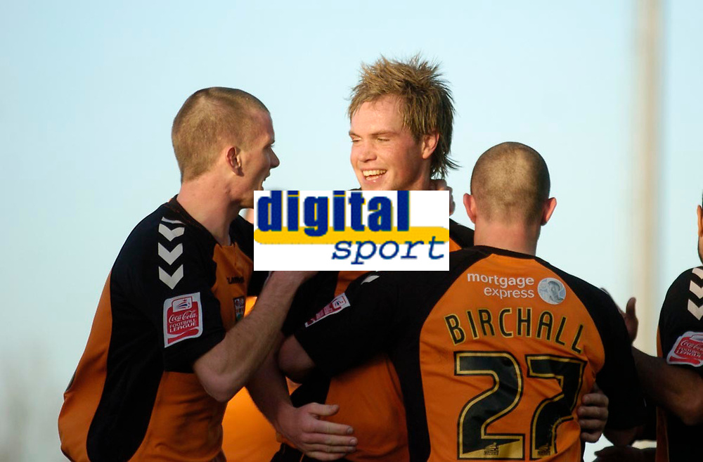 Photo: Leigh Quinnell.<br /> Milton Keynes Dons v Barnet. Coca Cola League 2. 20/01/2007. Barnets Simon King(C) is congratulated on his goal by Barry Cogan(L) and Adam Birchall(R)