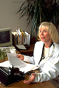 Physician doctor psychologist age 60 working at desk.  Golden Valley Minnesota USA
