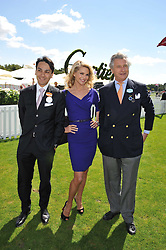 Left to right, FRANCOIS LE TROQUER  Managing Director Cartier UK, CHRISTIE BRINKLEY and ARNAUD BAMBERGER Executive Chairman Cartier UK at the 27th annual Cartier International Polo Day featuring the 100th Coronation Cup between England and Brazil held at Guards Polo Club, Windsor Great Park, Berkshire on 24th July 2011.