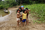 Ecuador, May 9 2010: Jorge poses with children from one of the Huaorani communities. Copyright 2010 Peter Horrell