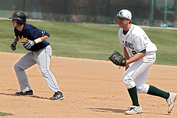 12 April 2014:  Trace Gingerich takes a lead as Nick Hahn protects first base during an NCAA division 3 College Conference of Illinois and Wisconsin (CCIW) baseball game between the Augustana Vikings and the Illinois Wesleyan Titans at Jack Horenberger Stadium, Bloomington IL