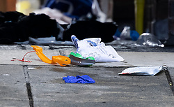 © Licensed to London News Pictures. 06/07/2021. London, UK. Clothing and medical equipment lie on the ground at a housing estate off Oval Place in south London where a 16 year old boy was stabbed to death last night. Police were called at around 23:45hrs on Monday, 5 July, to a teenager stabbed in Oval Place, SW8. Officers attended along with London Ambulance Service. The 16-year-old male was pronounced dead at the scene. Photo credit: Peter Macdiarmid/LNP