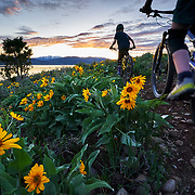 Jade Goodrich poses for a moment while mountain biking at sunset in Wyoming.