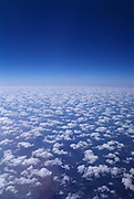 Looking down on clouds in a blue sky.
