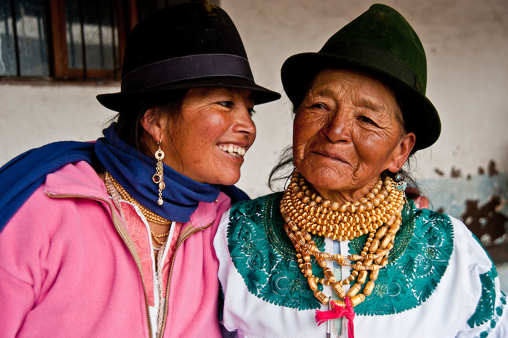 Two women proudly delivers milk from their two cows to the quality testing facility in the Andes of Ecuador.