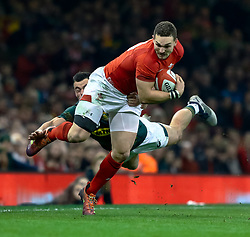 George North of Wales evades the tackle of  Jesse Kriel of South Africa<br /> <br /> Photographer Simon King/Replay Images<br /> <br /> Under Armour Series - Wales v South Africa - Saturday 24th November 2018 - Principality Stadium - Cardiff<br /> <br /> World Copyright © Replay Images . All rights reserved. info@replayimages.co.uk - http://replayimages.co.uk