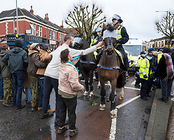 © Licensed to London News Pictures; 10/03/2021; Bristol, UK. Police use horses as supporters of squatters being evicted try to stop a police van leaving with a squatter who has been arrested by police after being evicted from a large empty office building by police and bailiffs on Gloucester Road in North Bristol. The squatters say they are called The Pigeon Shit Collective, because of the Government's failings, and they are giving support to homeless people and those in need during the covid-19 coronavirus pandemic. Photo credit: Simon Chapman/LNP.