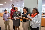 Purchase, NY – 31 October 2014. Ziyah House, in the orange scarf, from Port Chester High School, practicing her presentation. The Business Skills Olympics was founded by the African American Men of Westchester, is sponsored and facilitated by Morgan Stanley, and is open to high school teams in Westchester County.