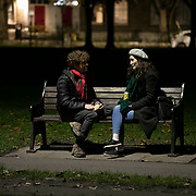 Ben and Megan<br /> Ben is a software engineer and Megan works in musical education.<br /> <br /> It is their first date and after a long walk they enjoy a couple of drinks on a bench. <br /> Spurred on by lockdown Ben asked Megan out and even on a cold Sunday night a bench can be a warm place.<br /> <br /> Living alone and working from home because of lockdown can be tough when the only physical social interaction is going to the shops. They both live according to lockdown rules but after having had a window of relative freedom over the summer and almost a year of Covid19 they both feel the fatigue many people feel about the pandemic. In spite of they both know people who has had, and survived, Covid19, both feel less scared now they have learned to live with the restrictions.
