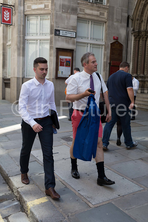 As heatwave temperatures climb to record levels - the hottest day of the year so far - Londoners in the City of London the capitals financial district aka the Square Mile took to wear informal dress codes including shorts and sports shirts, on 25th July 2019, in London, England.