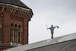 © Licensed to London News Pictures . 15/09/2015 . Manchester , UK . STUART HORNER on the roof at HMP Manchester (formerly Strangeways Prison ), this morning (15th September 2015) . Photo credit : Joel Goodman/LNP
