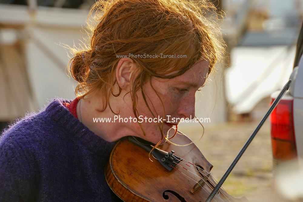 Portrait of ginger haired female violinist
