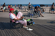 Relaxing in style on the boardwalk at Coney Island.