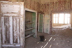 WINDHOEK, Nov. 25, 2013  Photo taken on Nov. 23, 2013 shows the interior of an abandoned building in ''Ghost Town'' Kolmanskop, Namibia. Kolmanskop is a ghost town in the Namib desert in southern Namibia. In 1908 a diamond was found in this area, which led to a huge and frantic diamond rush by German settlers. Driven by the enormous wealth of the first diamond miners, the residents built the village in the architectural style of a German town, with amenities and institutions including a hospital, ballroom, school, casino and even an x-ray-station. The town declined after World War I when the diamond field slowly exhausted and was ultimately abandoned in 1954. Now it is a popular tourist destination. (Xinhua/Gao Lei) (Credit Image: å© Gao Lei/Xinhua/ZUMAPRESS.com)
