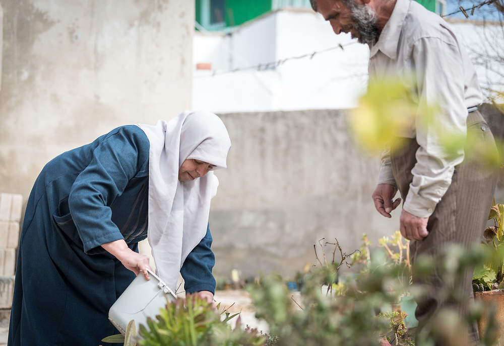 16 February 2020, Irbid, Jordan: Fatima Al-Omari (left) and her husband Mahmoud Al-Omari (right) work in their garden in Al-Mazar. They are among many beneficiaries to recently have received support from the LWF in setting up home-based farming in the area of Al-Mazar. By providing tools and seeds, the project has helped 150 families grow food for themselves and, in some cases, also earn an income from selling their surplus at local markets.