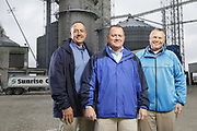 SHOT 10/29/18 9:46:09 AM - Sunrise Cooperative is a leading agricultural and energy cooperative based in Fremont, Ohio with members spanning from the Ohio River to Lake Erie. Sunrise is 100-percent farmer-owned and was formed through the merger of Trupointe Cooperative and Sunrise Cooperative on September 1, 2016. Photographed at the Clyde, Ohio grain elevator was George D. Secor President / CEO and John Lowry<br /> Chairman of the Board of Directors with  CoBank RM Gary Weidenborner. (Photo by Marc Piscotty © 2018)