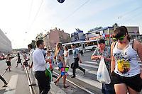 Pedestrians cross the street to enter the Proletarskaya green line metro stop into St. Petersburg, Russia.
