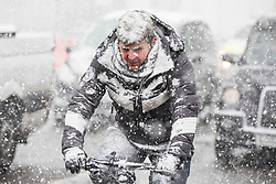 © Licensed to London News Pictures. 28/02/2018. London, UK. A cyclist gets caught in heavy snow on Whitehall in central London. Severe weather is set to continue as the 'Beast from the East' brings freezing Siberian air to the UK. Photo credit: Rob Pinney/LNP