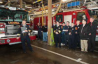 Laconia Fire Chief Kenneth Erickson welcomes firefighters and city officials to the blessing and dedication of the new Engine 1 at Central Station on Tuesday afternoon.  (Karen Bobotas/for the Laconia Daily Sun)