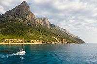 Scenic aerial view of boat sailing along Sardinia coastal line, Italy.