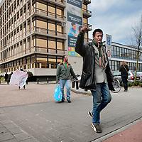 Nederland, Amsterdam , 16 april 2015.<br /> Illegalen in hun tijdelijk nieuwe onderkomen op de Jan Tooropstraat.<br /> Op de foto: Illegalen vertrekken vanuit de Jan Tooropstraat naar Den Haag om daar te gaan demonstreren.<br /> Illegal immigrants in their temporary new home at  the Jan Tooropstraat in Amsterdam are on their way to The Hague to protest.