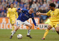 Photo: Leigh Quinnell.<br /> Leicester City v Preston North End. Coca Cola Championship. 15/04/2006. Leicesters Iain Hume can't find a way past Prestons Youl Mawene.