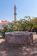 An ancient water well uncovered and preserved in Jaffa, Israel. Muhamidiya mosque (Great Mosque) in the background