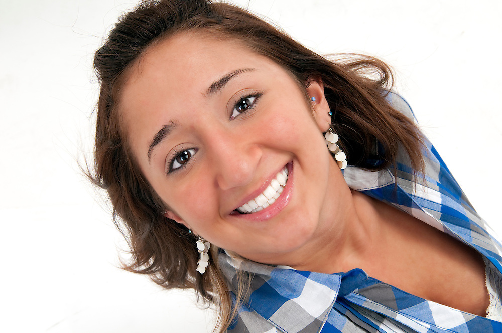 Young hispanic girl looking at camera and smiling, very happy.