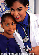 Doctor, Physician at Work, African American  Female Physician and Black Child Patient