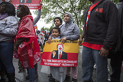 May 24, 2017 - Chicago, USA - Reyna Carbajal [cq], second from right, and her two sons, Breylan, front, and Erick Gayton, participate in a protest outside of the McDonald's Corporate office headquarters, Wednesday, May 24, 2017, in Oak Brook, Illinois. (Credit Image: © Alyssa Pointer/TNS via ZUMA Wire)