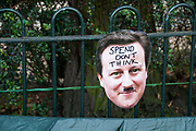 Occupy London October 23rd 2011. Finsbury Square. David Cameron mask with 'Spend Don't Think' written on his forehead.
