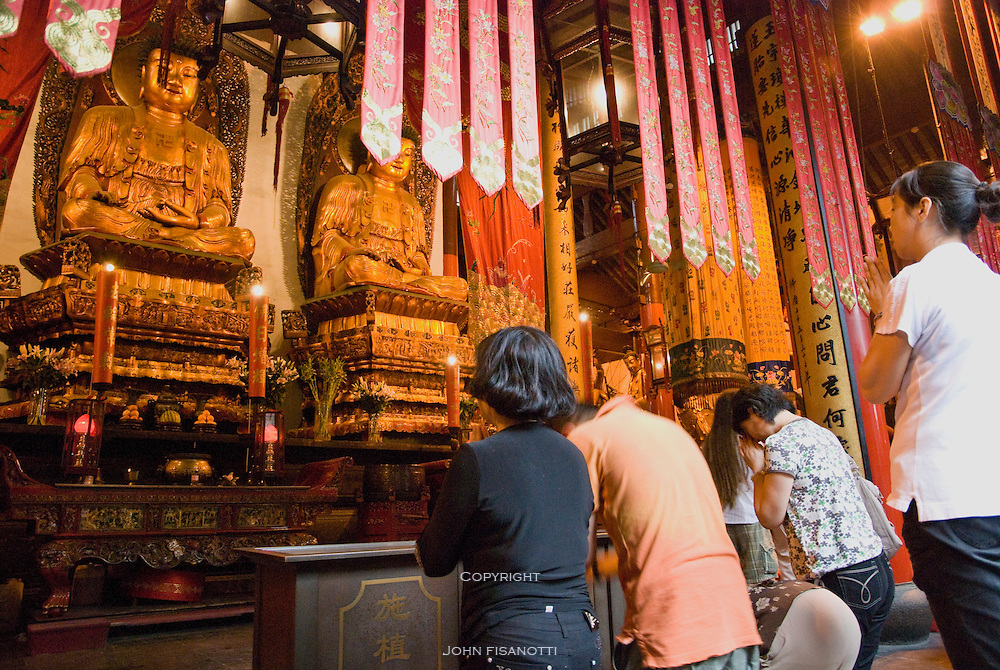 A family prays in the temple