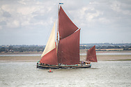 A traditional Thames sailing barge on an English river