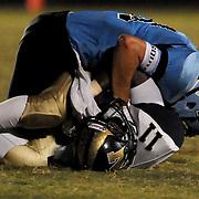 North Brunswick High School's Shack Graham is tackled by South Brunswick High School's Nicklaus Beecroft Friday September 13, 2013. (Jason A. Frizzelle)