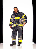 """Firefighter, Engine<br /> Rescued many from Tower No. 1<br /> <br /> """"I stepped outside after bringing about 40 or 50 people down a stairway. I looked around. It was crazy. Somebody yelled, 'Look out! The tower's coming down!' I started running. I tossed my air mask away to make myself lighter. Next thing I know, there's a big black ball of smoke. I threw myself on my knees, and I'm crying. I said to myself, 'Oh, my God, I'm going to die.' I was crawling. Then—the biggest miracle thing in the world. My hands came onto an air mask. It still had air. Another 15 seconds, I wouldn't have made it."""""""