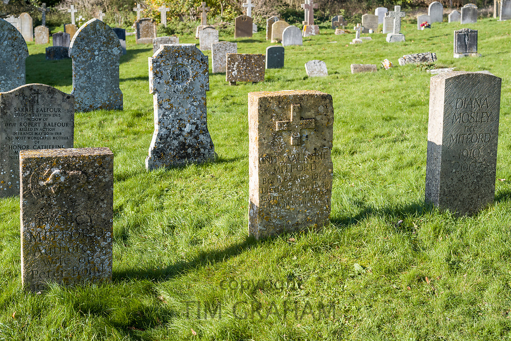Headstones of the graves of the famous Mitford family - Nancy, Unity and Diana (Mosley) in the churchyard of St Mary's Church in Swinbrook in The Cotswolds, Oxfordshire