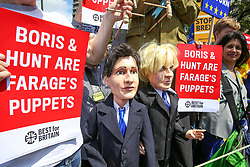 "© Licensed to London News Pictures. 20/07/2019. London, UK. Pro EU protesters with two puppets, the Conservative leadership candidates BORIS JOHNSON and JEREMY HUNT during the ""No to Boris. Yes to Europe"" march in central London. Photo credit: Dinendra Haria/LNP"