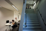 Mature student studies in isolation in the Daniel Libeskind designed Graduate Centre at London Metropolitan University's Holloway Road campus.