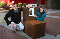 © Licensed to London News Pictures. 13/12/11 London, UK. .Sculptor Antony Gormley, and English PEN Assistant Director Sarah Hesketh with a picture of Liu Xiaobo the imprisoned winner of the 2010 winner of the Nobel Literature Prize on new work, 'Witness' outside The British Library, London. The piece was commissioned by English PEN to mark it's 90th anniversary and is cast in iron depicting an empty chair to represent writers around the world..Photo credit : Simon Jacobs/LNP
