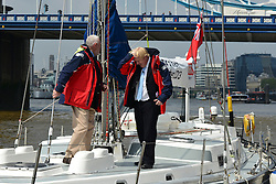 © Licensed to London News Pictures. 31/05/2013. London, UK London Mayor Boris Johnson (r) and yachtsman Sir Robin Knox-Johnston attend a photocall at the start and finish line of the 2013-14 Clipper Round the World Yacht Race. The race will leave London on 1 September 2013 and not return until July 2014. Photo credit : Stephen Simpson/LNP