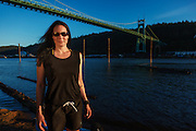 USA, Oregon, Portland, Cathedral Park, woman at Cathedral Park in front of St. John's Bridge. MR