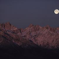 SIERRA NEVADA. Moonset over Mt.Whitney (L) Owens Valley fgnd.