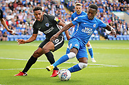 Peterborough United midfielder Siriki Dembele (10) and Portsmouth defender Nathan Thompson (20) during the EFL Sky Bet League 1 match between Peterborough United and Portsmouth at London Road, Peterborough, England on 15 September 2018.