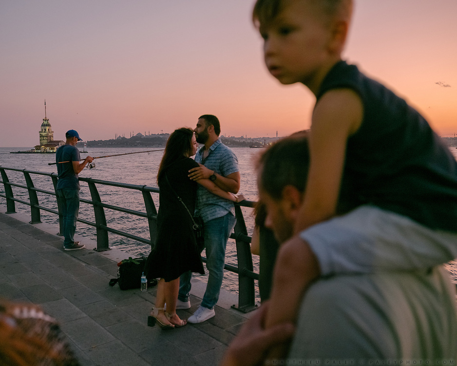 Life on the promenade along the Bosphorus, on the coast of Uskudar, opposite the islet of Maiden's Tower.