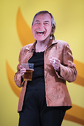 © Licensed to London News Pictures . 09/03/2014 . York , UK . Lorelei Burt MP for Solihull comes on to the stage dressed in a Nigel Farage mask with a cigarette and a pint of beer , ahead of the leader's speech . The third and final day of the Liberal Democrat Spring Conference today (Sunday 9th March 2014) . Photo credit : Joel Goodman/LNP