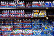 Plastic water bottles on shelves of supermarket, Los Angeles, California, USA