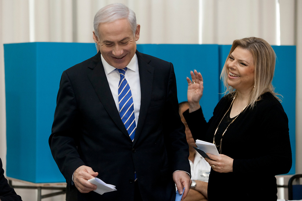 Israel's Prime Minister and Likud party leader Benjamin Netanyahu and his wife Sara smile, while casting their vote during the Likud party primary elections, at a polling station in Jerusalem, Israel, on January 31, 2012.