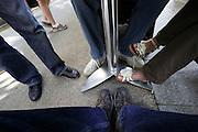 feet of people sitting at a sidewalk bar