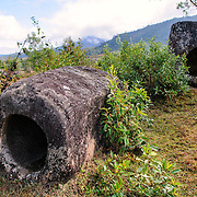 A stone jar on its side at Site 3 of the Plain of Jars in north-central Laos. Much remains unknown about the age and purpose of the thousands of stone jars clustered in the region. Most accounts date them to at least a couple of thousand years ago and theories have been put forward that they were used in burial rituals.