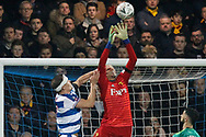 Queens Park Rangers forward Matt Smith (17) appears to foul Watford goalkeeper Heurelho Gomes (1) during The FA Cup 5th round match between Queens Park Rangers and Watford at the Loftus Road Stadium, London, England on 15 February 2019.